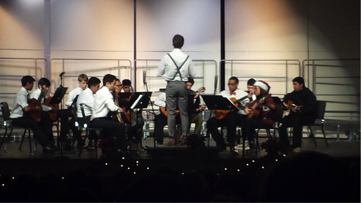 The Guitar Ensemable, led by Mr. Walker, performs at Winter Concert. (Photo by Jasmyne Singleton)