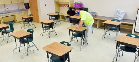 An FCPS employee prepares for socially distanced in-person school