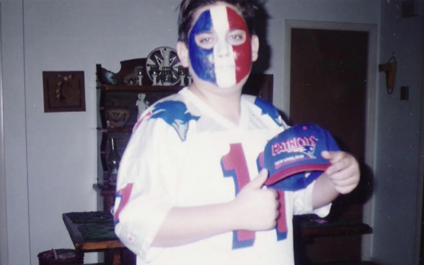 History Teacher Joshua Toth roots for the Patriots as a young fan.